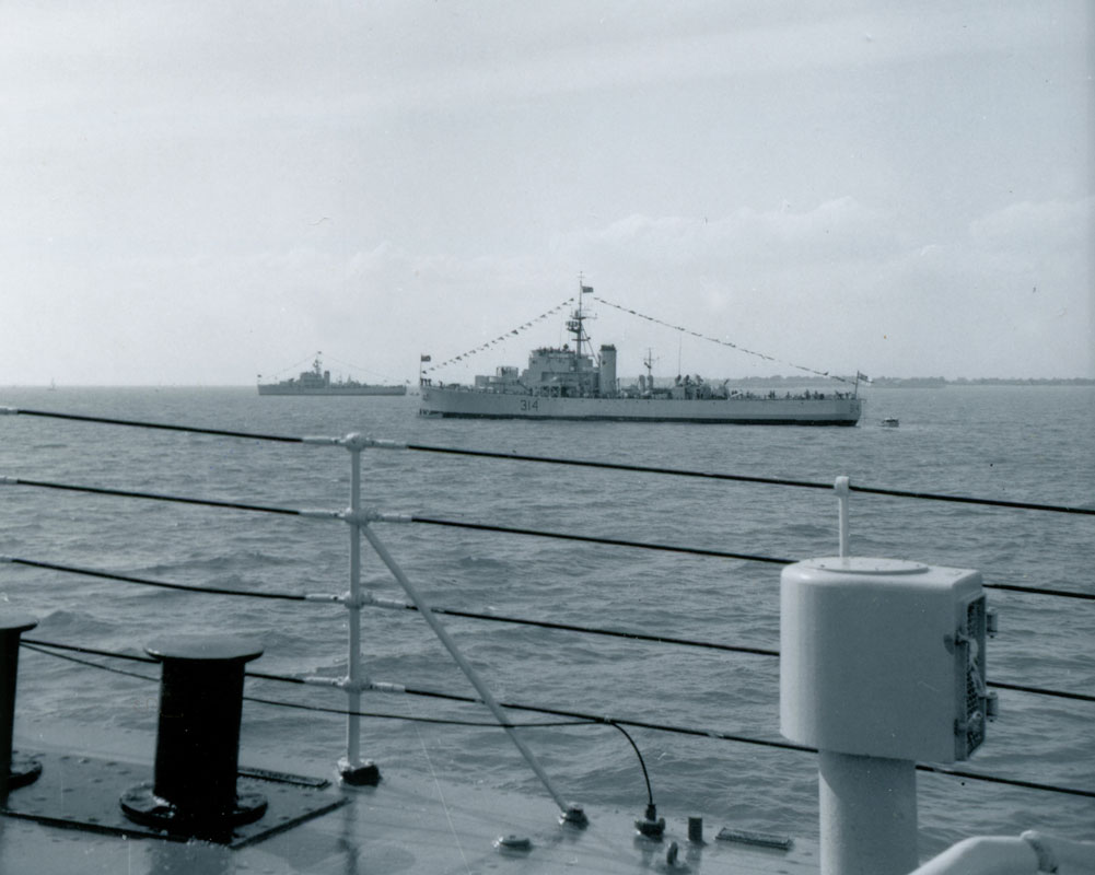 HMCS Buckingham, dressed ship, Spithead, England, Victoria Day, May 18, 1964.