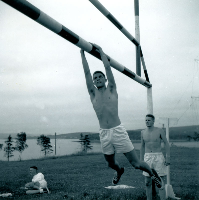 UNTD Sports Tabloid, HMCS Cornwallis, July 1964, Carl Holm on bar, Peter Kincaid behind, Frank Baker on ground, all Haida Division.